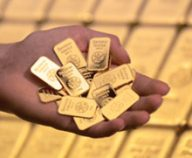 Goldbars in hand